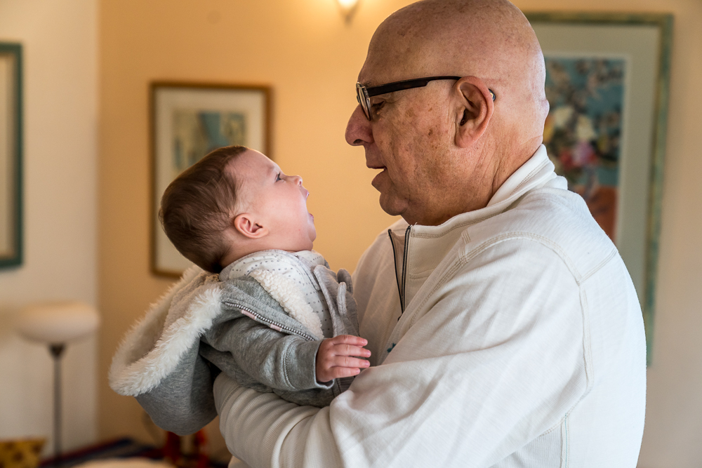 A loving look between grandpa and grandchild
